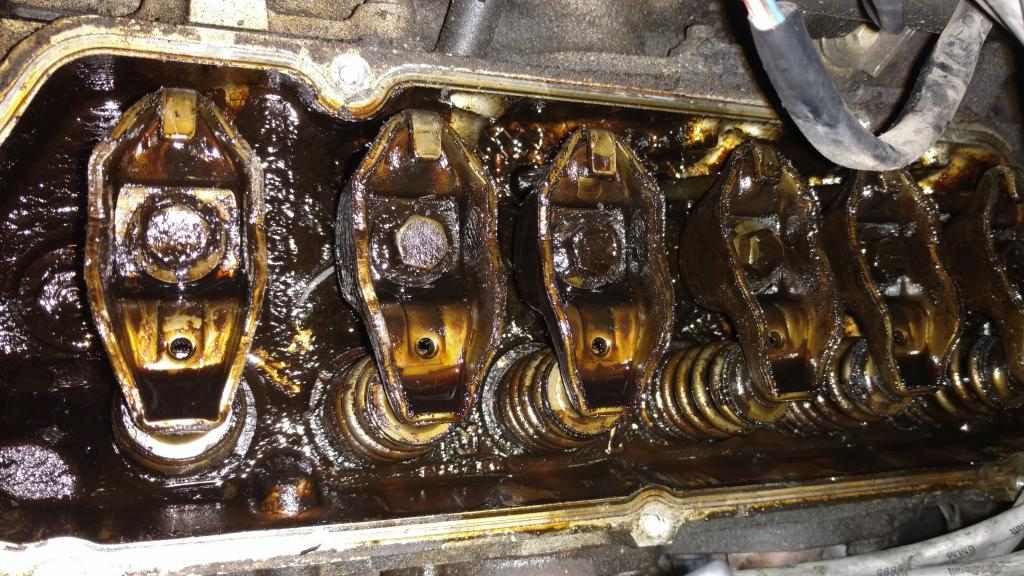 Cleaning Sludge from Under Valve Covers - Bob Is The Oil Guy